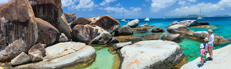 Family of mother and kids enjoying view of beautiful scenery of The Baths beach area major tourist attraction at Virgin Gorda, British Virgin Islands, Caribbean photo