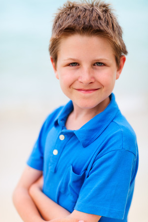 nine years old: Nine years old boy wearing blue t-shirt outdoors on summer