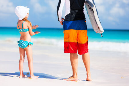 Father and his adorable little daughter at beach photo