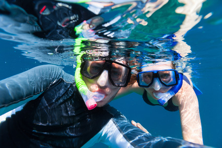 Underwater photo of a young couple snorkeling at tropical ocean  Stock Photo - 30963532