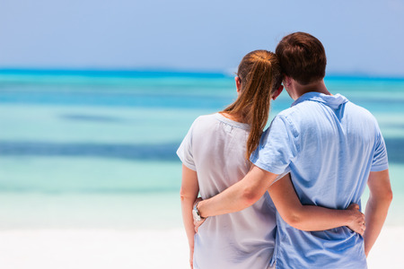 Back view of a couple on a tropical beach vacation Stock Photo - 30963550