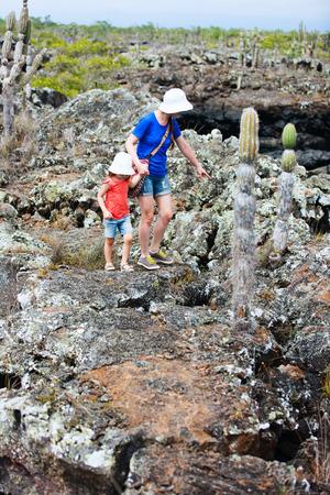 Mother and daughter hiking at Los Tuneles, Galapagos islands, Ecuador photo