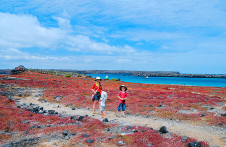 Mother and two kids hiking on Galapagos island of South Plaza photo