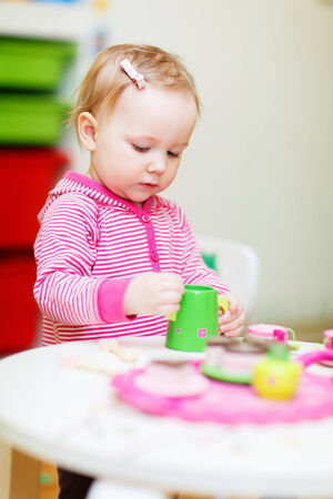 playtime: Adorable toddler girl playing with toys at home or daycare place