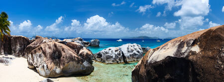Panorama of The Baths beach area major tourist attraction at Virgin Gorda, British Virgin Islands with turquoise water and huge granite boulders photo