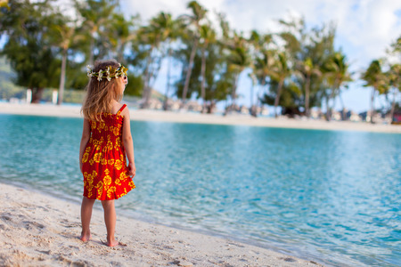 Little girl wearing Polynesian dress at beach on Bora Bora Stock Photo