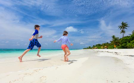 kids having fun: Small kids having fun at tropical beach