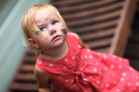 smudgy: Adorable toddler girl with dirt all over her face Stock Photo