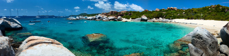 virgin: Panorama of The Baths beach area major tourist attraction at Virgin Gorda, British Virgin Islands with turquoise water and huge granite boulders, perfect for banners