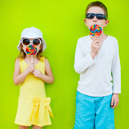 lollipop: Adorable little kids with colorful lollipops Stock Photo