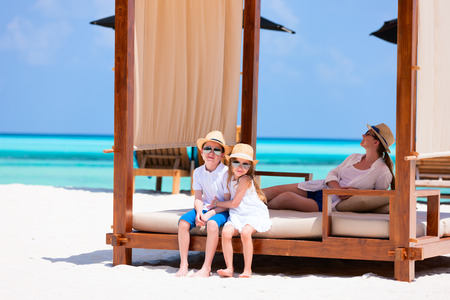cabana: Happy beautiful family relaxing at beach during summer vacation Stock Photo