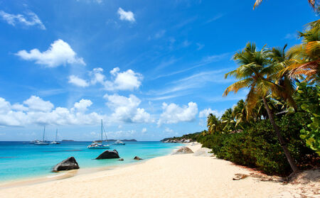Stunning beach with white sand, unique huge granite boulders, turquoise ocean water and blue sky at Virgin Gorda, British Virgin Islands in Caribbean Stock Photo