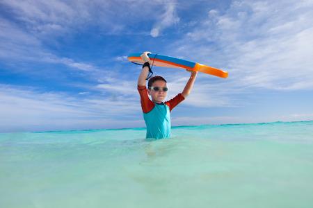 boogie: Little boy on vacation having fun surfing on boogie board