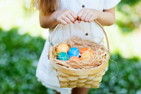 egg hunt: Close up of colorful Easter eggs in a basket Stock Photo