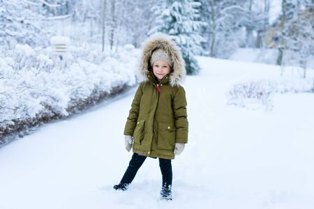 parka: Adorable little girl outdoors on beautiful winter snow day