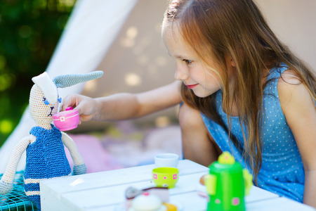 kids party: Adorable little girl having fun playing outdoors on summer day