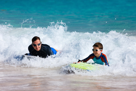 boogie: Father and son surfing on boogie boards