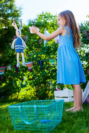 tipi: Adorable little girl having fun playing outdoors on summer day
