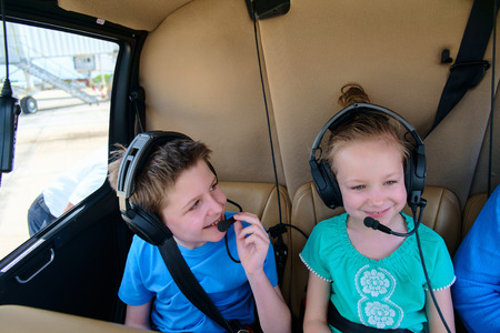 Kids at cabin of helicopter before scenic flight