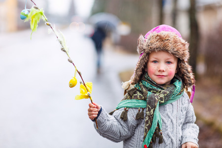 finland: Adorable little girl outdoors dressed for Easter traditional celebration in Finland Stock Photo