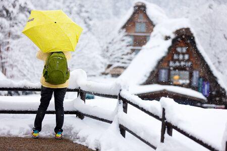 shirakawago: Back view of a tourist at historic Japanese village Shirakawa-go at winter