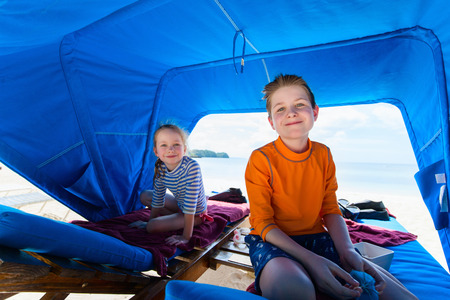 cabana: Kids at luxury resort relaxing at beach cabana