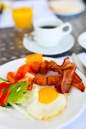 bacon and eggs: Delicious breakfast with fried eggs, bacon and vegetables Stock Photo