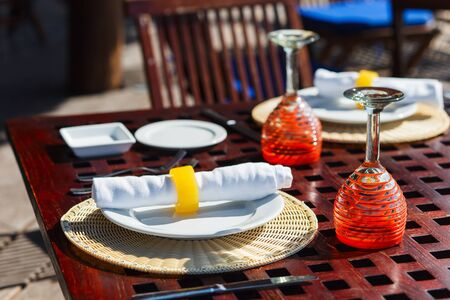 restaurant tables: Table setting in a restaurant for romantic lunch or dinner Stock Photo