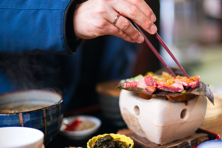 hida: Traditional Japanese lunch with hida beef prepared on grill Stock Photo