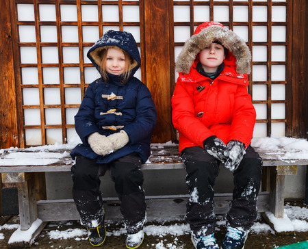 parka: Adorable little girl and cute boy outdoors on beautiful winter day