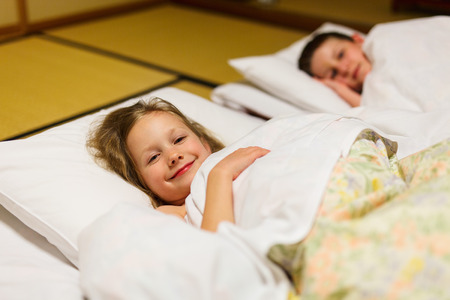 futon: Kids sleeping on futons at traditional Japanese style room