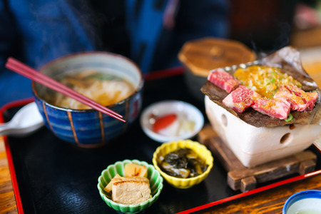 japanese foods: Traditional Japanese lunch with hida beef prepared on grill Stock Photo