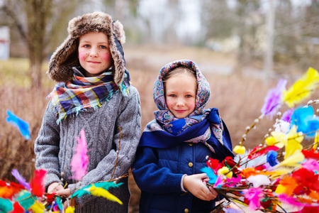 palm sunday: Kids outdoors dressed for Easter traditional celebration in Finland Stock Photo