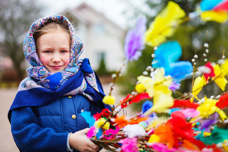 Adorable little girl outdoors dressed for Easter traditional celebration in Finland Stock Photo