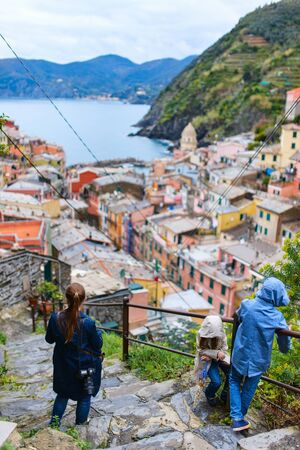 cinque: Family of mother and kids enjoying scenic view of colorful village Vernazza, Cinque Terre, Italy