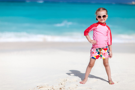 little girl swimsuit: Portrait of cute little girl at tropical beach
