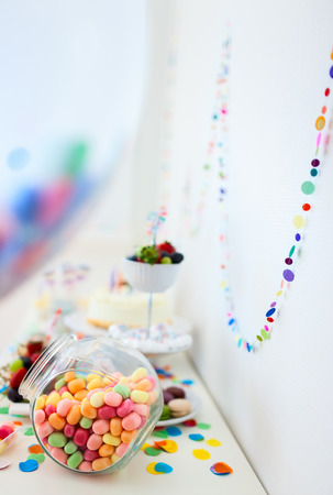 dessert table: Cake, candies, marshmallows, cakepops, fruits and other sweets on dessert table at kids birthday party Stock Photo