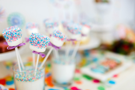 kids birthday party: Colorful decoration of kids birthday party table with marshmallows and sweets