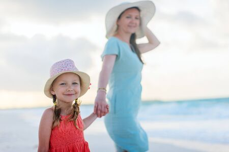 Portrait of young mother and her adorable little daughter on vacation photo