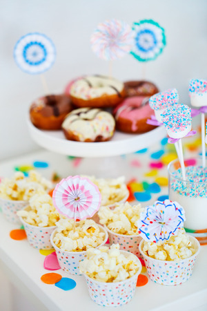 dessert table: Donuts and other sweets on dessert table at kids birthday party Stock Photo