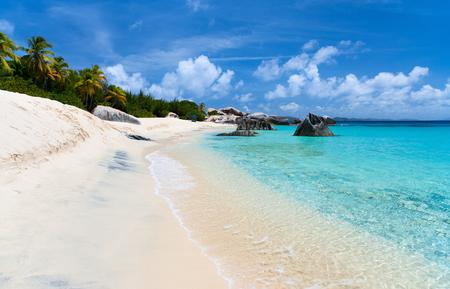 virgin islands: Beautiful tropical beach with white sand, turquoise ocean water and blue sky at Virgin Gorda, British Virgin Islands in Caribbean