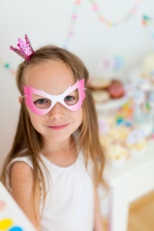 kids birthday party: Adorable little girl with princess crown at kids birthday party Stock Photo