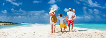 family vacations: Panorama of  a happy family with kids on tropical beach vacation