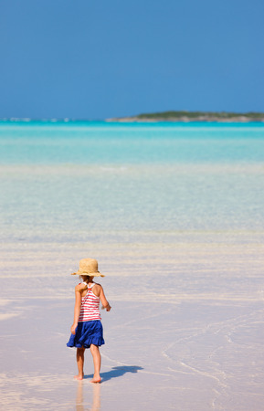 unrecognisable person: Back view of a little girl at remote tropical beach during Caribbean summer vacation