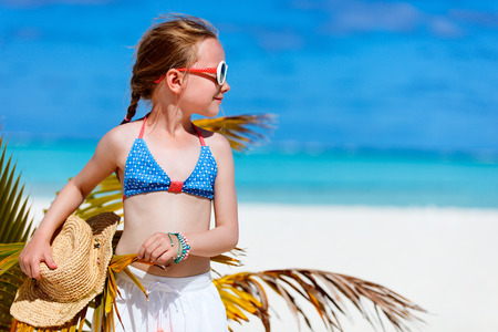 children clothing: Adorable little girl at beach during summer vacation