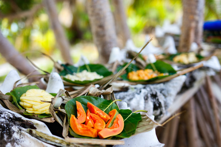 close up food: Close up of some local south pacific origin food served in giant shells