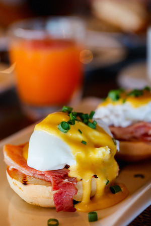 morning breakfast: Delicious breakfast with eggs Benedict and juice Stock Photo