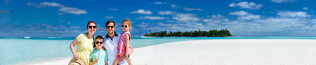 beach panorama: Panorama of happy beautiful family with kids walking together on tropical beach during summer vacation Stock Photo