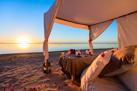 romantic places: Romantic luxury dinner setting at tropical beach on sunset