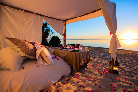 Romantic luxury dinner setting at tropical beach on sunset Stok Fotoğraf - 44406715